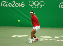 Olympic champion Rafael Nadal of Spain in action during men`s singles first round match of the Rio 2016 Olympic Games Stock Photography