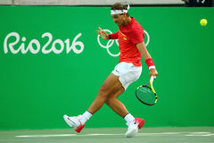 Olympic champion Rafael Nadal of Spain in action during men's singles quarterfinal of the Rio 2016 Olympic Games Stock Image