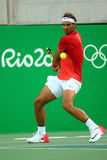 Olympic champion Rafael Nadal of Spain in action during men's singles quarterfinal of the Rio 2016 Olympic Games Stock Images