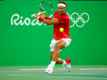 Olympic champion Rafael Nadal of Spain in action during men's singles quarterfinal of the Rio 2016 Olympic Games Stock Photos