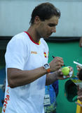 Olympic champion Rafael Nadal of Spain gives autographs after men`s singles semifinal of the Rio 2016 Olympic Games Stock Photo