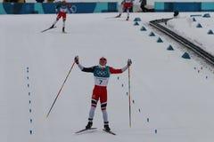 Olympic Champion Simen Hegstad Krueger of Norway at finish line at mass start in the Men`s 15km + 15km Skiathlon. PYEONGCHANG, SOUTH KOREA - FEBRUARY 11, 2018 stock images