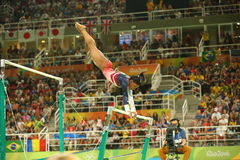Free Olympic Champion Simone Biles Of United States Competes On The Uneven Bars At Women S Team All-around Gymnastics At Rio 2016 Stock Photography - 77464642