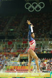 Olympic champion Simone Biles of United States competes on the balance beam at women's team all-around gymnastics at Rio 2016 Stock Photography