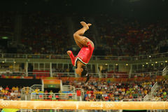 Olympic champion Simone Biles of United States competes at the final on the balance beam women`s artistic gymnastics at Rio 2016. RIO DE JANEIRO, BRAZIL AUGUST Royalty Free Stock Photo