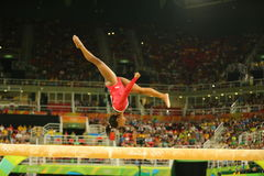 Olympic champion Simone Biles of United States competes at the final on the balance beam women`s artistic gymnastics at Rio 2016. RIO DE JANEIRO, BRAZIL AUGUST Stock Photos