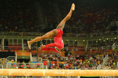 Olympic champion Simone Biles of United States competes at the final on the balance beam women`s artistic gymnastics at Rio 2016. RIO DE JANEIRO, BRAZIL AUGUST Royalty Free Stock Photos