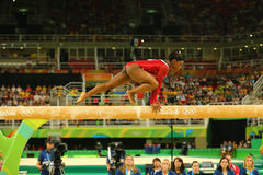 Olympic champion Simone Biles of United States competes at the final on the balance beam women`s artistic gymnastics at Rio 2016. RIO DE JANEIRO, BRAZIL AUGUST Royalty Free Stock Image
