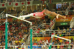 Olympic champion Simone Biles of United States competes on the uneven bars at women's team all-around gymnastics at Rio 2016 Stock Photography