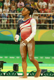Olympic champion Simone Biles of United States competes on the uneven bars at women's team all-around gymnastics at Rio 2016 Royalty Free Stock Photography