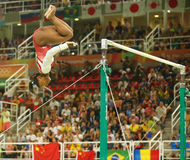 Olympic champion Simone Biles of United States competes on the uneven bars at women's team all-around gymnastics at Rio 2016 Stock Photos