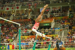 Olympic champion Simone Biles of United States competes on the uneven bars at women's team all-around gymnastics at Rio 2016 Stock Images