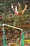 Olympic champion Simone Biles of United States competes on the uneven bars at women's team all-around gymnastics at Rio 2016  Royalty Free Stock Image