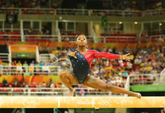 Olympic champion Simone Biles of United States competing on the balance beam at women`s all-around gymnastics qualification. RIO DE JANEIRO, BRAZIL AUGUST 7 Stock Photo