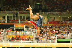 Olympic champion Simone Biles of United States competing on the balance beam at women`s all-around gymnastics qualification. RIO DE JANEIRO, BRAZIL AUGUST 7 Royalty Free Stock Photography