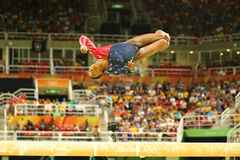 Olympic champion Simone Biles of United States competing on the balance beam at women`s all-around gymnastics qualification. RIO DE JANEIRO, BRAZIL AUGUST 7 Royalty Free Stock Photos