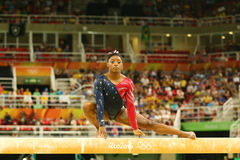 Olympic champion Simone Biles of United States competing on the balance beam at women`s all-around gymnastics qualification. RIO DE JANEIRO, BRAZIL AUGUST 7 Stock Photography