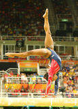 Olympic champion Simone Biles of United States competing on the balance beam at women`s all-around gymnastics qualification. RIO DE JANEIRO, BRAZIL AUGUST 7 Royalty Free Stock Image
