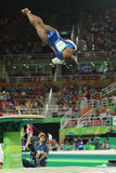 Olympic champion Simone Biles of United States competing a vault at women`s all-around gymnastics at Rio 2016 Olympic Games. RIO DE JANEIRO, BRAZIL - AUGUST 11 stock photos