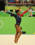 Olympic champion Simone Biles of USA competes on the floor exercise during women's all-around gymnastics qualification Royalty Free Stock Photography