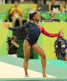 Olympic champion Simone Biles of USA competes on the floor exercise during women's all-around gymnastics qualification Stock Photo