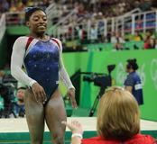 Olympic champion Simone Biles of USA after competing on the balance beam at women's all-around gymnastics at Rio 2016 Stock Image