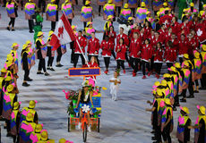 Olympic champion trampoline gymnast Rosie MacLennan carrying Canadian flag leading the Olympic team Canada in the Rio 2016 Opening Stock Photos