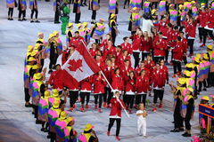 Olympic champion trampoline gymnast Rosie MacLennan carrying Canadian flag leading the Olympic team Canada in the Rio 2016 Opening. RIO DE JANEIRO, BRAZIL Stock Photos