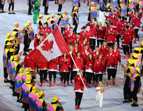 Olympic champion trampoline gymnast Rosie MacLennan carrying Canadian flag leading the Olympic team Canada in the Rio 2016 Opening Stock Images