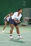 Olympic champions Serena and Venus Williams of USA in action during doubles first round match of the Rio 2016 Olympic Games Royalty Free Stock Images