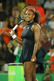 Olympic champions Serena Williams of United States celebrates victory after singles round two match of the Rio 2016 Olympic Games. RIO DE JANEIRO, BRAZIL stock photo
