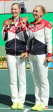 Olympic champions team Russia Ekaterina Makarova (L) and Elena Vesnina during medal ceremony after tennis doubles final Royalty Free Stock Photo