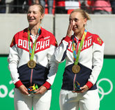 Olympic champions team Russia Ekaterina Makarova (L) and Elena Vesnina during medal ceremony after tennis doubles final Stock Photo