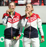 Olympic champions team Russia Ekaterina Makarova (L) and Elena Vesnina during medal ceremony after tennis doubles final Stock Image