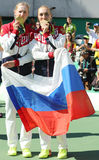 Olympic champions team Russia Ekaterina Makarova (L) and Elena Vesnina during medal ceremony after tennis doubles final Stock Photos