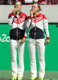 Olympic champions team Russia Ekaterina Makarova (L) and Elena Vesnina during medal ceremony after tennis doubles final Stock Photography