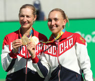 Olympic champions team Russia Ekaterina Makarova (L) and Elena Vesnina during medal ceremony after tennis doubles final Royalty Free Stock Image