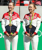 Olympic champions team Russia Ekaterina Makarova (L) and Elena Vesnina during medal ceremony after tennis doubles final Royalty Free Stock Photography