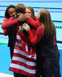 Olympic Champions team USA Women`s 4  100m medley relay celebrate victory at the Rio 2016 Olympic Games Royalty Free Stock Image
