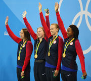 Olympic Champions team USA Women`s 4  100m medley relay celebrate victory at the Rio 2016 Olympic Games Stock Photos