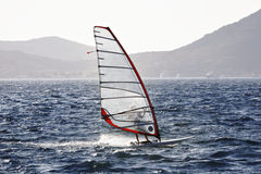 Olympic class RS:X wind surfer speeding Royalty Free Stock Photos