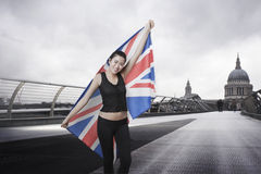 Olympic competitor with Union Jack in front of St Paul's Cathedral in London stock photos