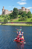 Olympic Crown passing Inverness Castle !. A raft with a red, white and blue Olympic crown, taking part in the Inverness Raft Race held on 18th August 2012 and Royalty Free Stock Photo