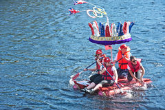 Olympic Crown on River Ness. A raft with a red, white and blue Olympic crown, taking part in the Inverness Raft Race held on 18th August 2012 and from which the Royalty Free Stock Photo