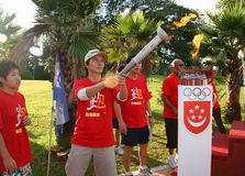 Olympic day run lighting torch Royalty Free Stock Photography
