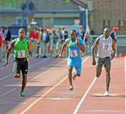 Olympic Development 100 meter dash Penn Relays. PHILADELPHIA - APRIL 30: Keston Bledman (3) wins the Olympic Development 100 meter dash at the 117th Penn Relays royalty free stock photos