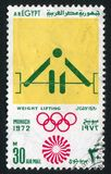 Olympic emblem. EGYPT - CIRCA 1972: stamp printed by Egypt, shows Weightlifting, Olympic emblem, circa 1972 Stock Photography