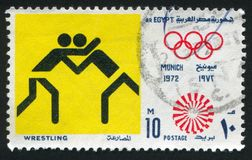 Olympic emblem. EGYPT - CIRCA 1972: stamp printed by Egypt, shows Wrestling, Olympic emblem, circa 1972 Royalty Free Stock Photos
