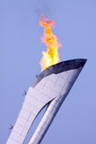 Olympic fire over bkue sky Royalty Free Stock Photos