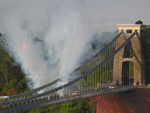 Olympic Fireworks. BRISTOL, UK, 23rd May, 2012.  To the accompaniment of fireworks the Olympic flame crosses Brunel's landmark Clifton suspension bridge over the Stock Image